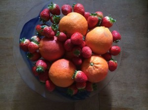 Delicious oranges and strawberries
