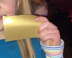 Evie Golden Ticket hand
